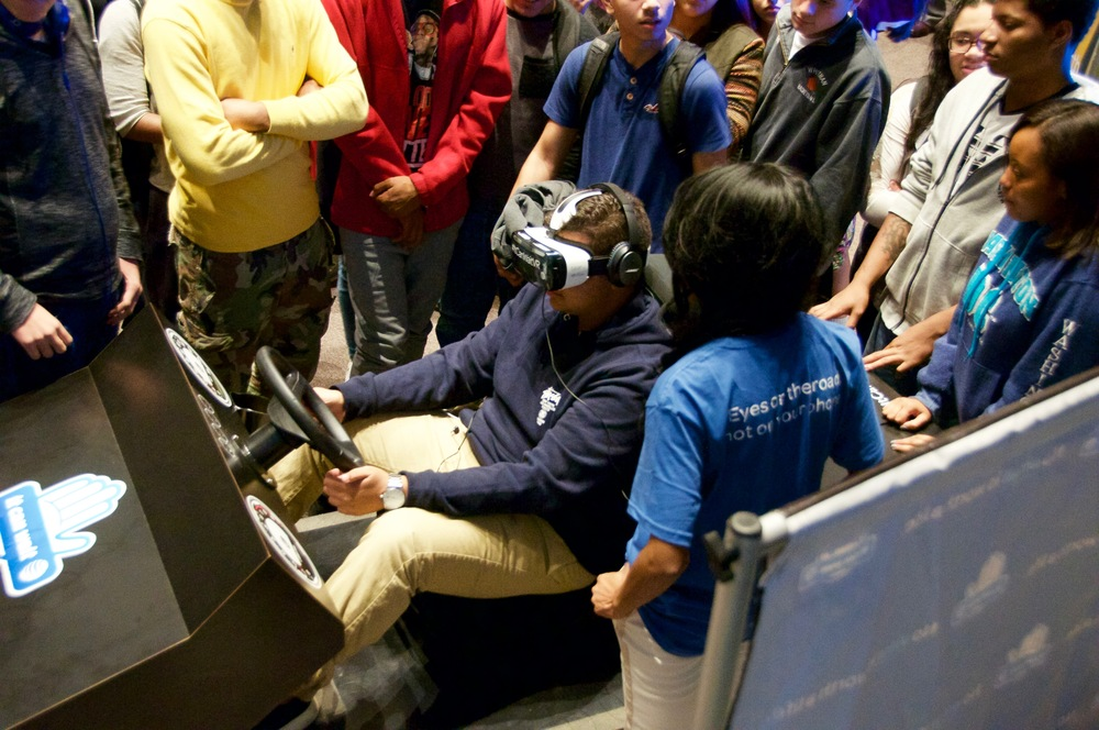 Walt Whitman High School student Daniel Moreira experiences a 3-D simulation meant to deter teens from texting while driving.