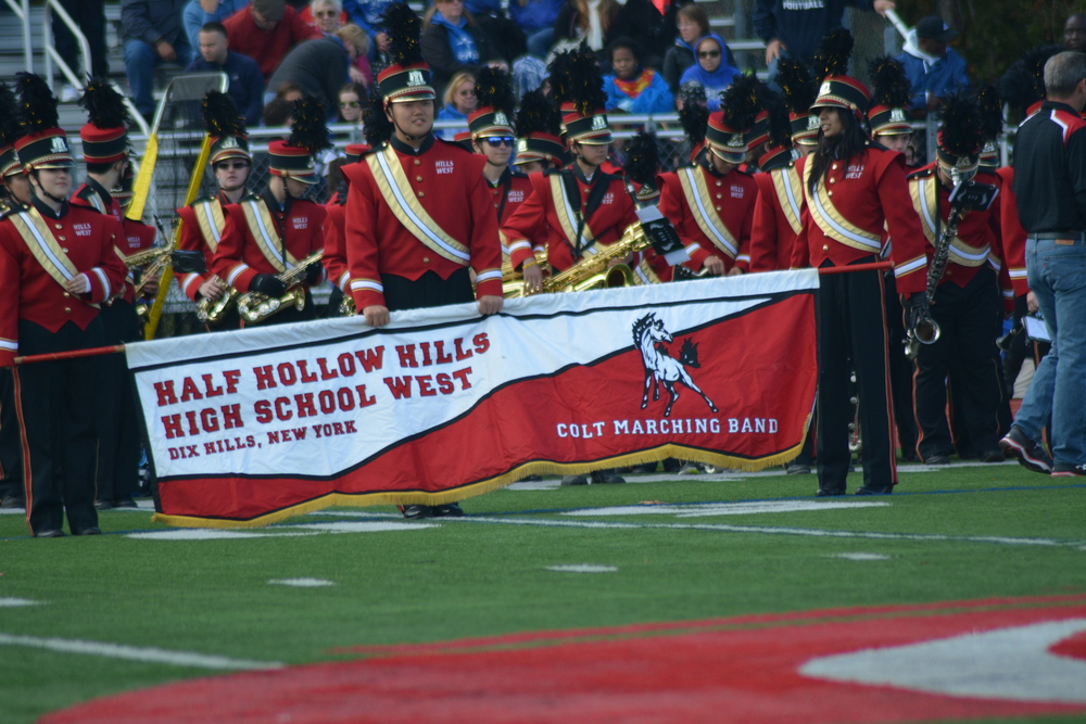 The Hills West Wranglerettes perform during halftime with the Colts Marching Band.