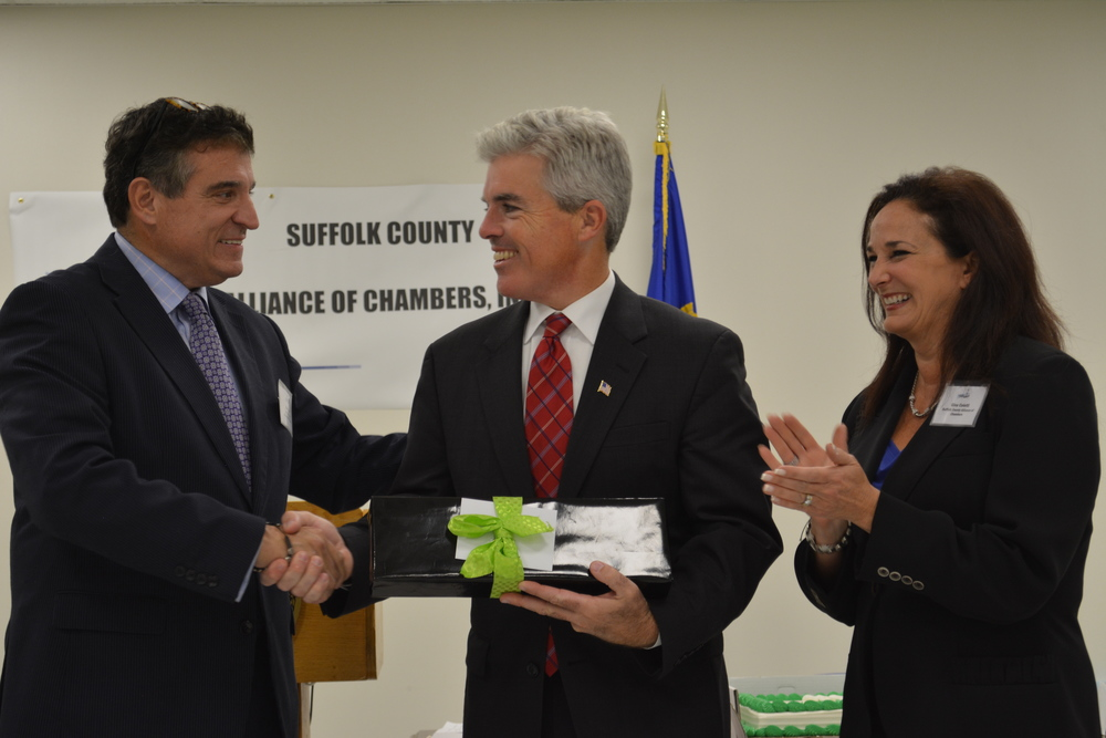 At Monday's first kick-off meeting of the Suffolk County Alliance of Chambers, Suffolk County Executive Steve Bellone is welcomed by Robert Fonti and Gina Coletti, directors and co-chairpersons of SCAC.