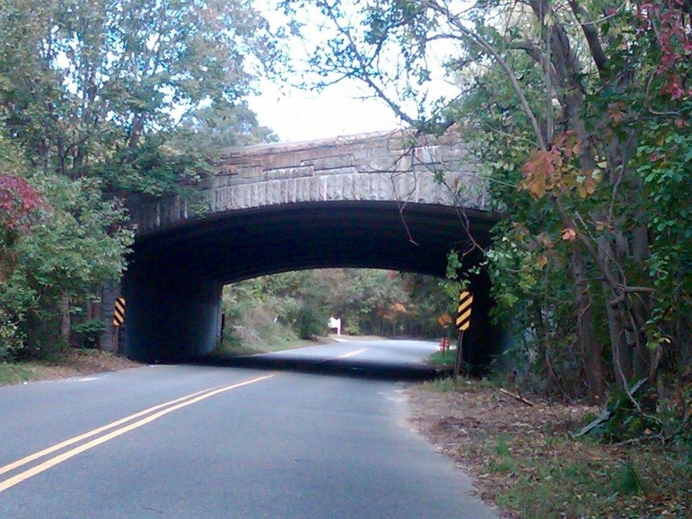An overpass on Sweet Hollow Road and its neighboring woods marks the area where sightings of ghosts and the supernatural have been recorded as legend tells. Photo by Jaclyn Gallucci