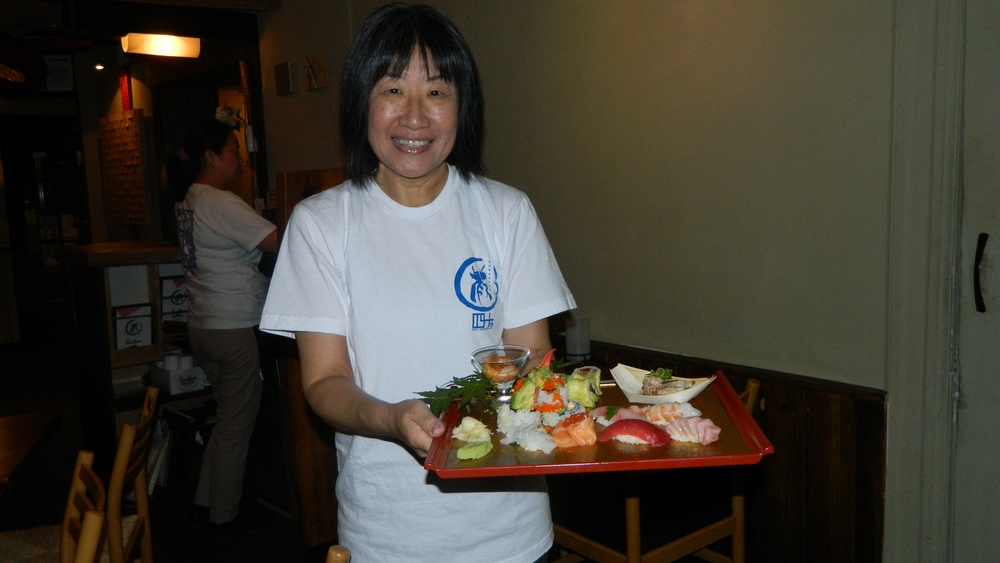 Owner Ayano Yamada presents the Omakase sushi platter.