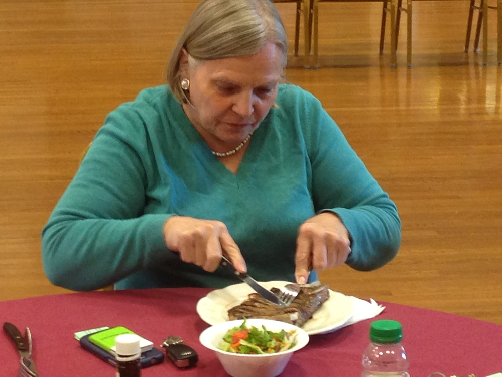 After giving blood at Huntington Fire Department's blood drive Monday, donor Elke Mariotti, of Huntington Station, enjoys a freshly-cooked steak dinner, offered in return for donations.