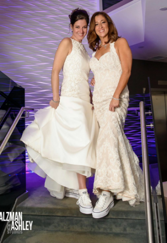 Julie Lauren Stark, left, and Alison Gail Rhein, wed Oct. 10 in Huntington. (Photo credit: Salzman Ashley Studios)