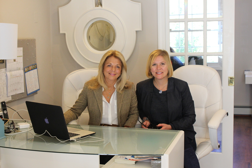 Elena D'Agostino, left, and Joyce Mennella, of Lucky To Live Here Realty, work from their office in Cold Spring Harbor, which opened in May.