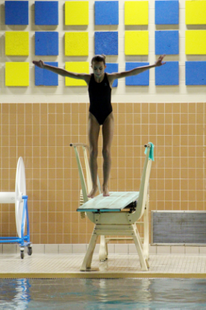 Camille Roberts, a freshman at Cold Spring Harbor High School, practicing her dives for the state championship, by jumping in the air before executing a perfect dive.