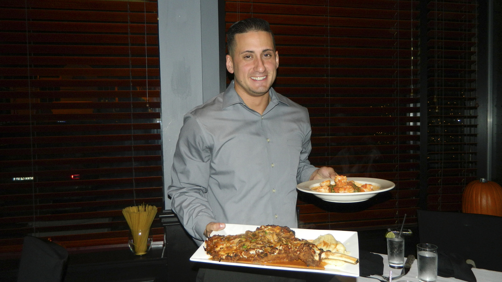Andrea's 25 Manager Tyson Loverro presents veal chop and shrimp Luciano entrees.