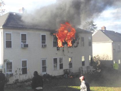 A fire engulfs an apartment complex at 250 Lowndes Ave. in Huntington Station Friday afternoon.