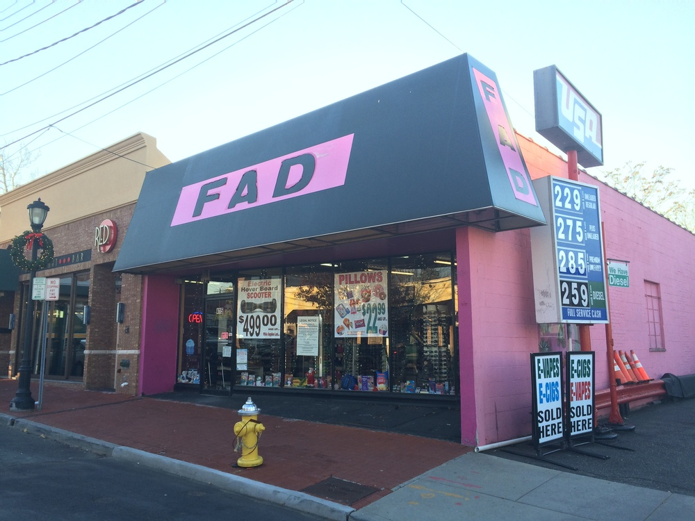 Owners of the Fad accessories store in Huntington village, above, are looking to build seven new apartments on two floors above the existing one-floor operation.