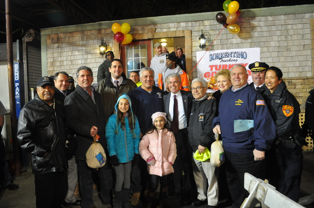 From left: Paul Johnson, civil rights activist; Assemblyman Andrew Raia (R-East Northport); Huntington Councilman Eugene Cook; Assemblyman Chad Lupinacci (R-South Huntington); Andre Sorrentino; Suffolk Executive Steve Bellone; Andrea Sorrentino; Huntington Town Clerk Jo-Ann Raia; Huntington Highway Superintendent Peter Gunther; Suffolk Police 2nd Precinct Deputy Inspector Bill Read; and 2nd Precinct Community Liaison Officer Claudia Delgado.
