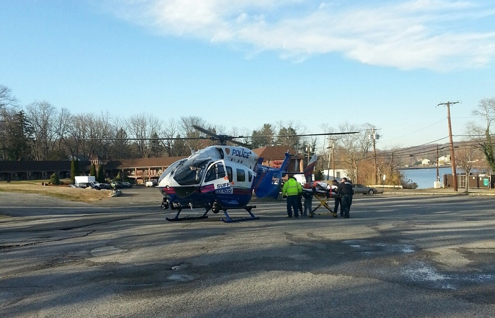 A Suffolk Police Medivac helicopter transported to Stony Brook University Medical Center a worker who fell off the roof of a condominium under construction in Centerport