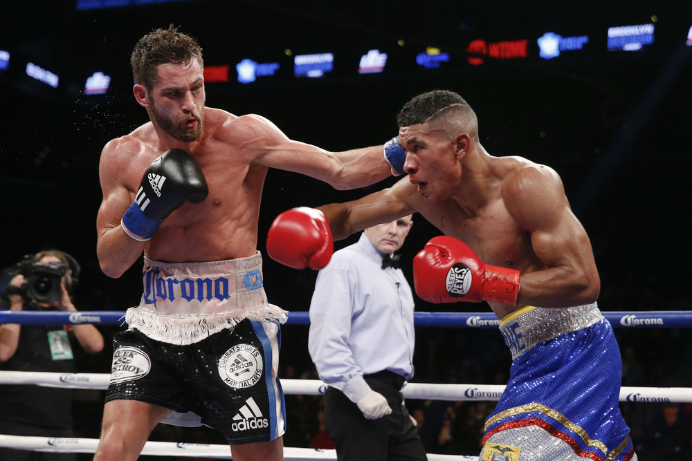 Greenlawn's Chris Algieri, left, defeated Erick Bone Saturday night in a 10-round welterweight bout at the Barclays Center in Brooklyn. Photo by Esther Lin