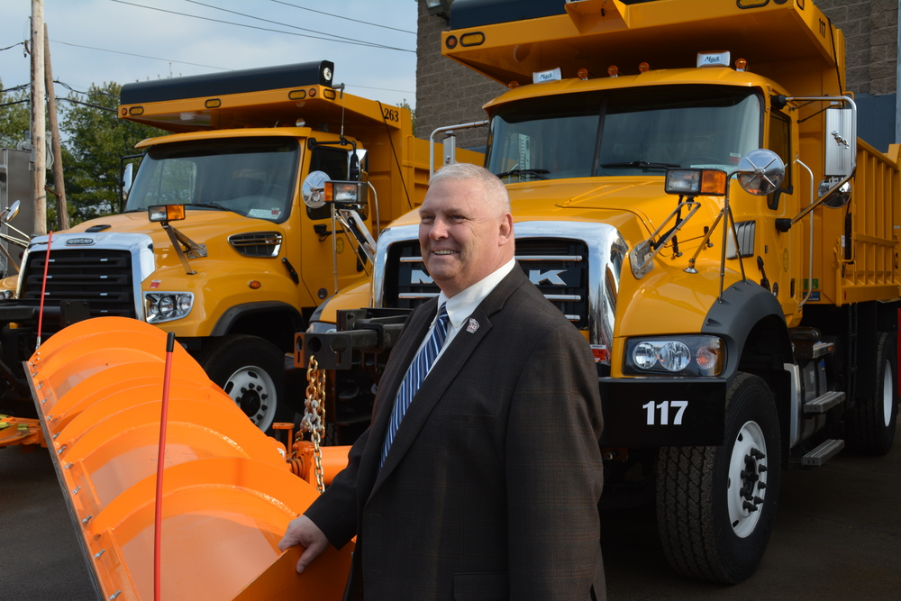 Huntington Highway Superintendent Peter Gunther unveiled Friday 10 new and 10 refurbished dump trucks that were purchased by the highway department as part of an effort to prepare for the looming winter season.