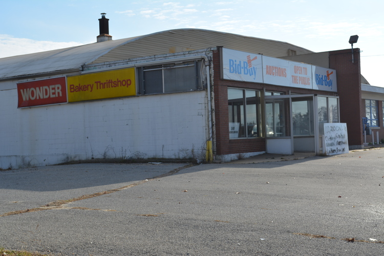 "Scotto Brothers catering company is talks to lease the former Wonder Bread Hostess warehouse on Route 110 in Melville, pictured, where it wants to build a 248-seat ""high-end"" restaurant."