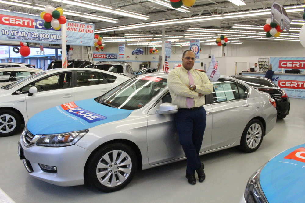 Eric Outcalt, fresh start program coordinator at Certi-Care Pre Owned of Huntington, stands next to a 2013 Honda Accord, which is a customer favorite at the Huntington Station dealership.