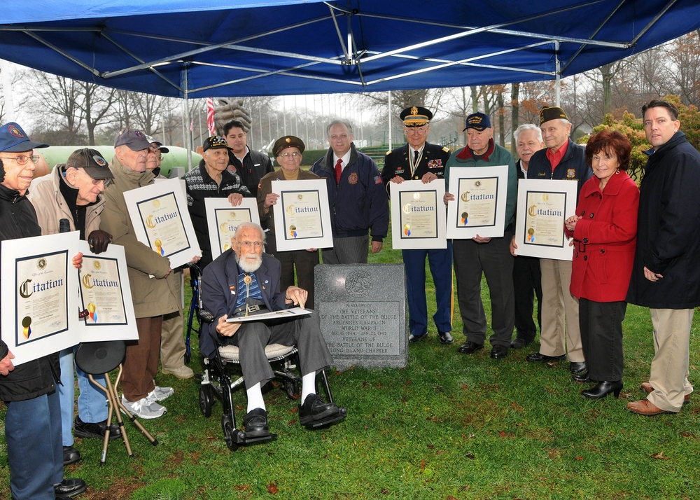 Local officials and 11 veterans of the World War II Battle of the Bulge attended a monument dedication on Dec. 23 in Veterans Memorial Plaza in Eisenhower Park.
