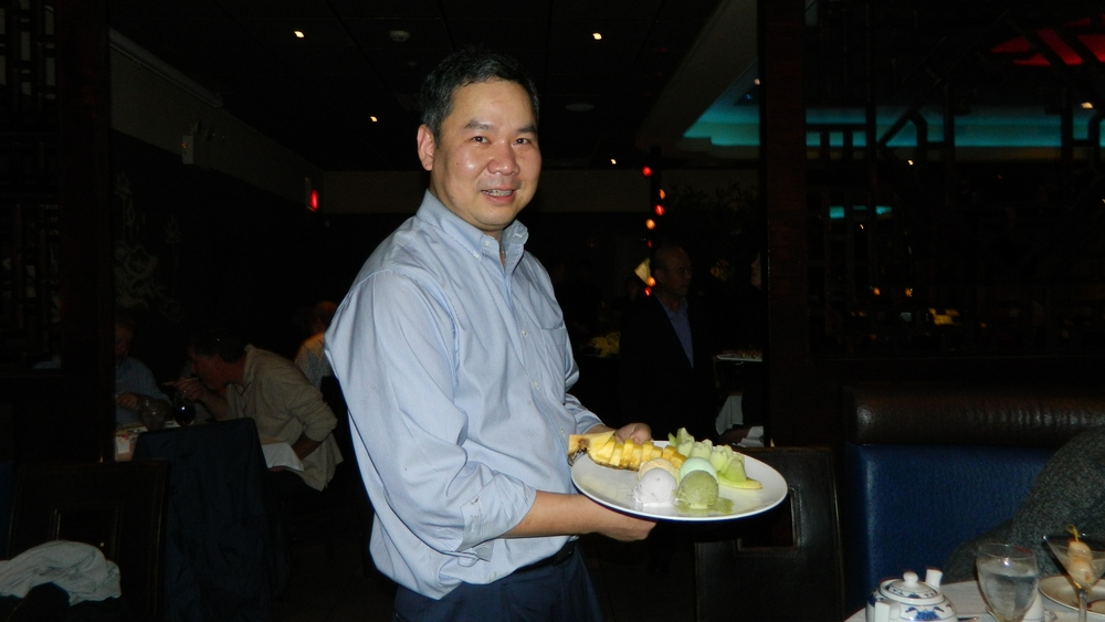 Manager Raymond Lin presents an ice cream and fruit platter.