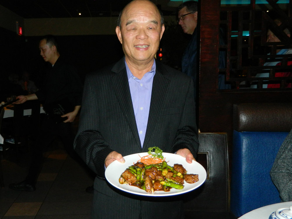 Mandarin Gourmet owner Albert Leung presents the restaurant's filet mignon entree.