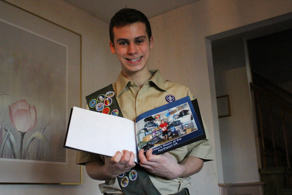 Eagle Scout Kyle Sambolin is all smiles holding up a photo that was taken of himself in the Northport VA donation room, after he helped to revitalize the room that had suffered from flood damage. Sambolin will be receive his Eagle Scout Award at the Huntington Elks Lodge on Monday.
