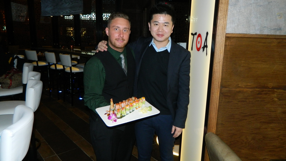 General Manager Kevin Inkles and owner Evan Chen present the Asian fusion restaurant's king lobster and angel hair rolls.