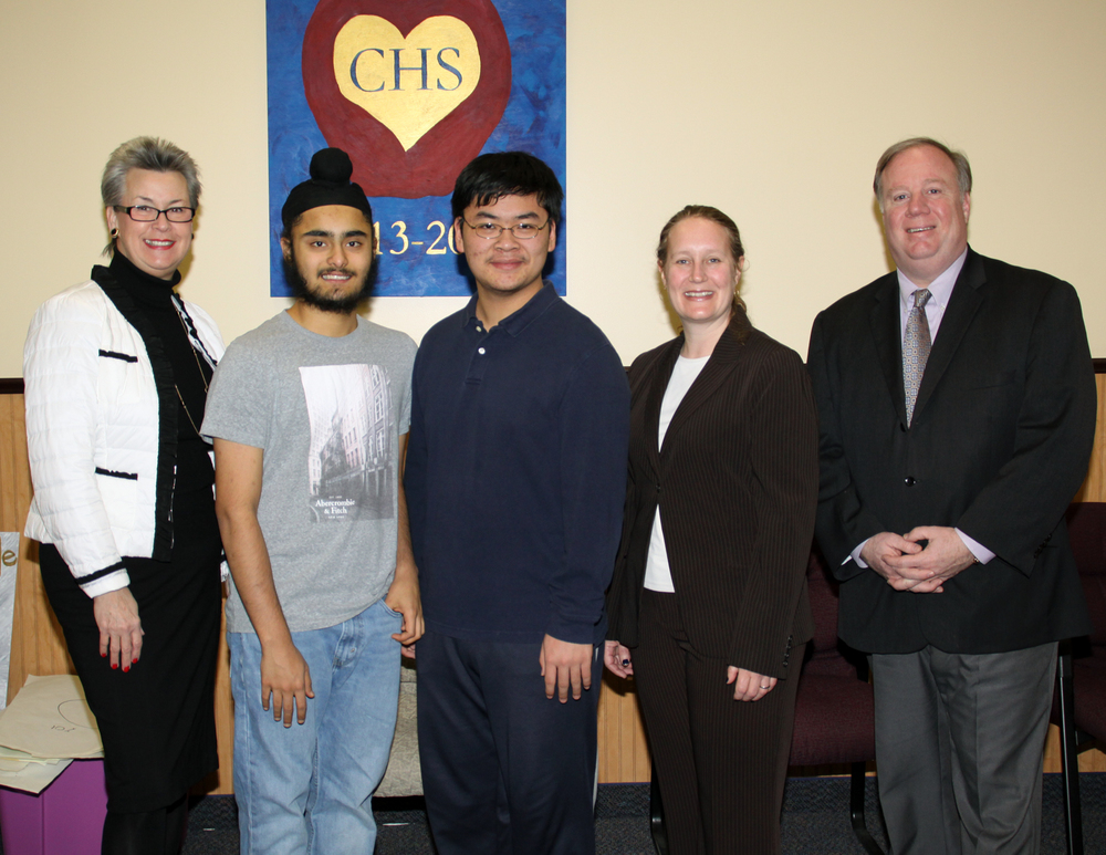Commack   High School   seniors Mehtaab Sawhney, second from left, and David Li, center, were named semifinalists in the 2016 Intel Science Talent Search competition. They're congratulated by Commack High School Principal Catherine Nolan; Commack's Director of Science Alison Celentano; and Commack Superintendent of Schools Donald James. Photo by Brenda Lentsch