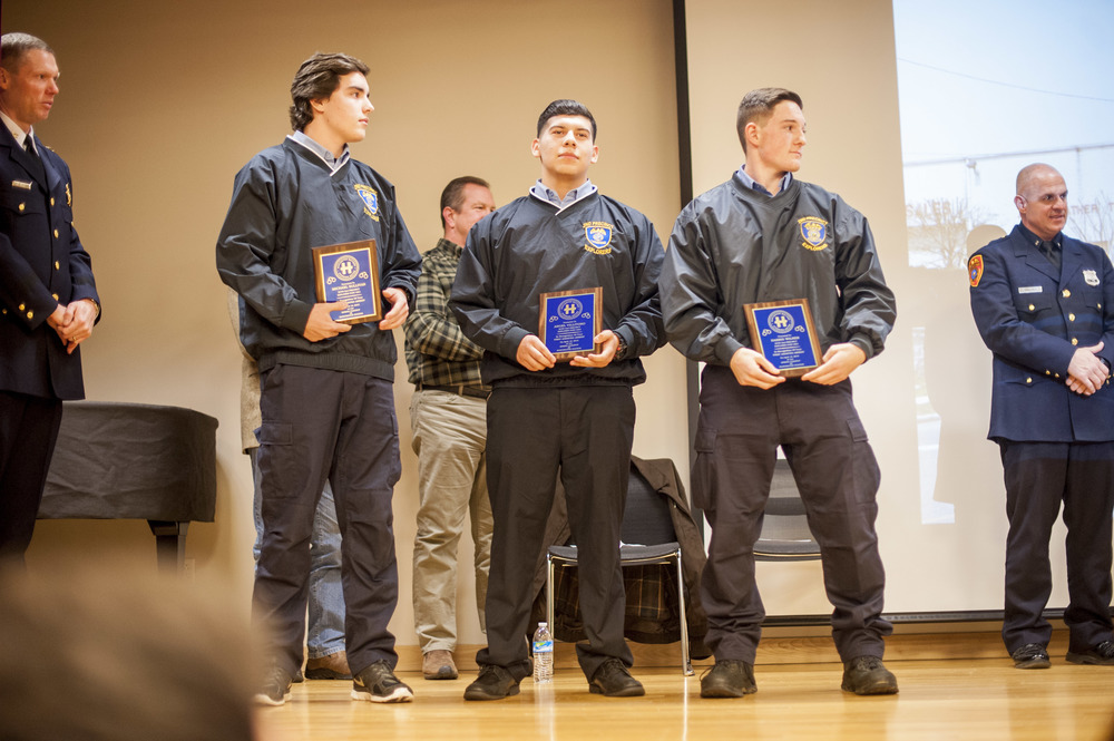 From left, Suffolk Police Explorers Michael Sullivan, Angel Villitoro and Harris Wilner are awarded certificates of appreciation for assisting in the arrest of an intoxicated man in April 2015.
