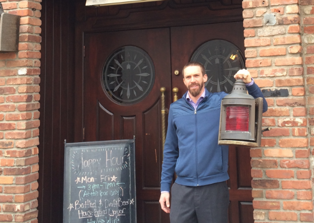 Paul Gallowitsch V, manager of Skipper's Pub, holds the recently-recovered port lamp that was stolen from outside the pub earlier this week. Gallowitsch said the lamp was anonymously left on the doorstep of Trinity Episcopal Church's Thrift Shop on Thursday. (Photo courtesy of Paul Gallowitsch V).
