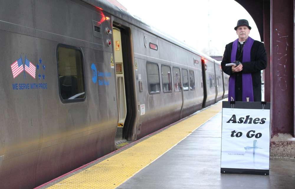 Rev. Joel Brandt, of the Gloria Dei Evangelical Lutheran Church in Huntington Station, was up bright and early at the Huntington Train Station, offering Ashes To Go on Ash Wednesday for those busy commuters.