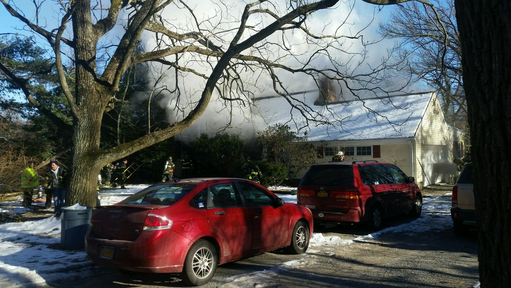 A house fire ripped through a Halesite home Sunday afternoon, main, and displaced a family of five, fire officials said.