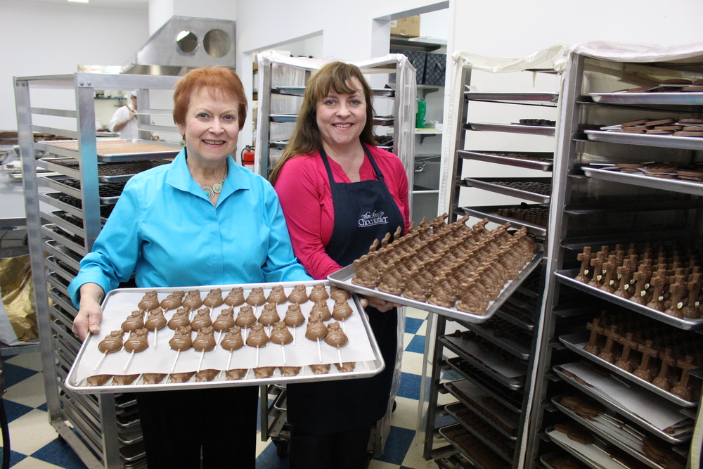 Co-owners of Bon Bons Chocolatier, Mary Alice and Susannah Meinersman, are preparing for the Easter season with armies of chocolate bunnies and chocolate bunny pops.