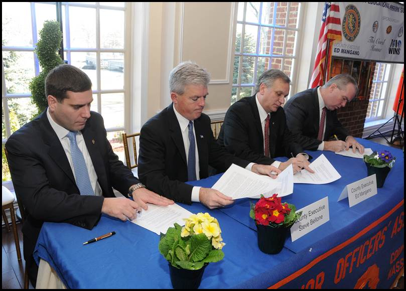 Suffolk County Executive Steven Bellone and Nassau County Executive Edward Mangano sign a memorandum of agreement to form the Long Island Heroin Task Force, a joint venture between the counties to stem the tide of the heroin epidemic .  Photo/Office of Nassau County Executive Edward Mangano