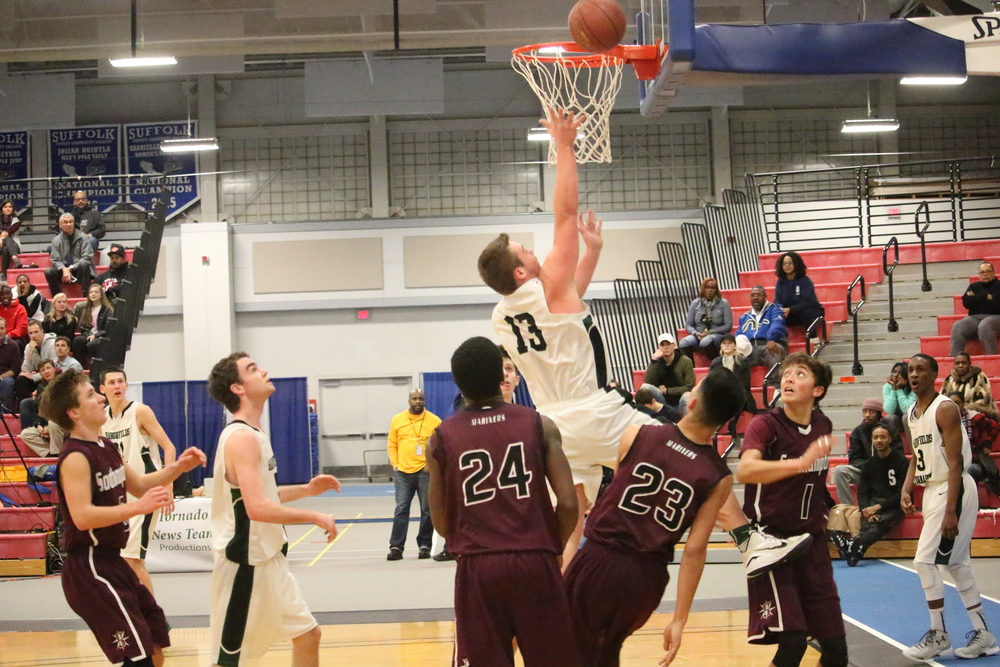 Nick Mitchell (No. 13) jumps for a layup during Suffolk's small-school championship game Tuesday night at Suffolk County Community College's Brentwood campus. Photos by Hansen Lee