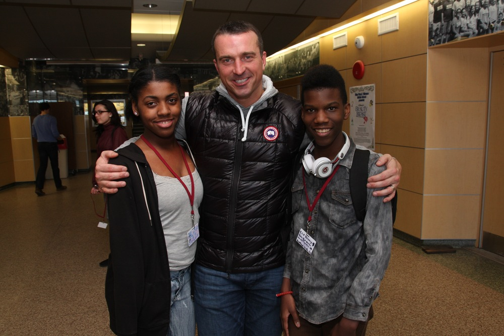Former NBA player Christopher Herren is pictured with two Walt Whitman students during his visit to the high school, during which he shared his story of overcoming his drug addiction. Photo by Steve Bartholomew