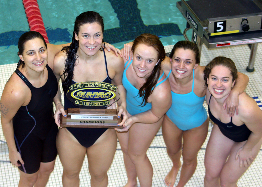 Northport graduate Hailey Modelewski, left-enter, holds the SUNYAC 2016 women's swimming and diving championship trophy with her SUNY Geneseo teammates. Photo By Chris Modelewski