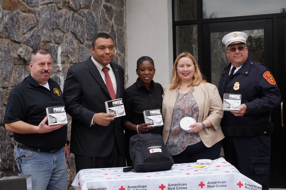 : From left, Huntington Manor Fire Chief Francis McQuade, Suffolk County Legislator William Spencer; Nassau County Legislator Siela Bynoe; interim Chief Executive Officer of Long Island chapter of the American Red Cross Elizabeth Barker; and Suffolk Fire Marshal Joseph Kuethen. Photo/Michael de Vulpillieres