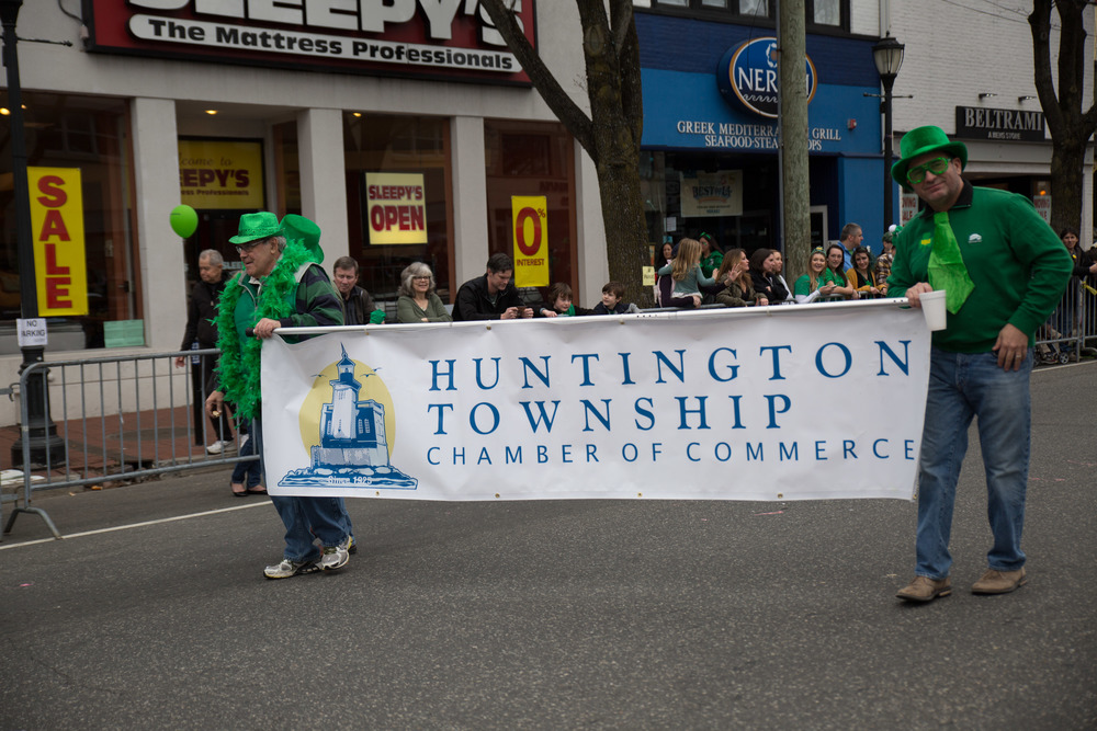 Huntington Township Chamber of Commerce board members Vincent Casillo, left, Robert Bontempi, right, march up Main Street.