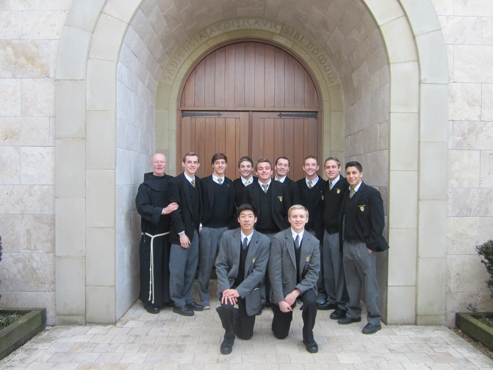 Members of the St. Anthony's Friars swim team are pictured with Bro. Gary Cregan, OSF, principal of the high school. Photo provided by St. Anthony's High School