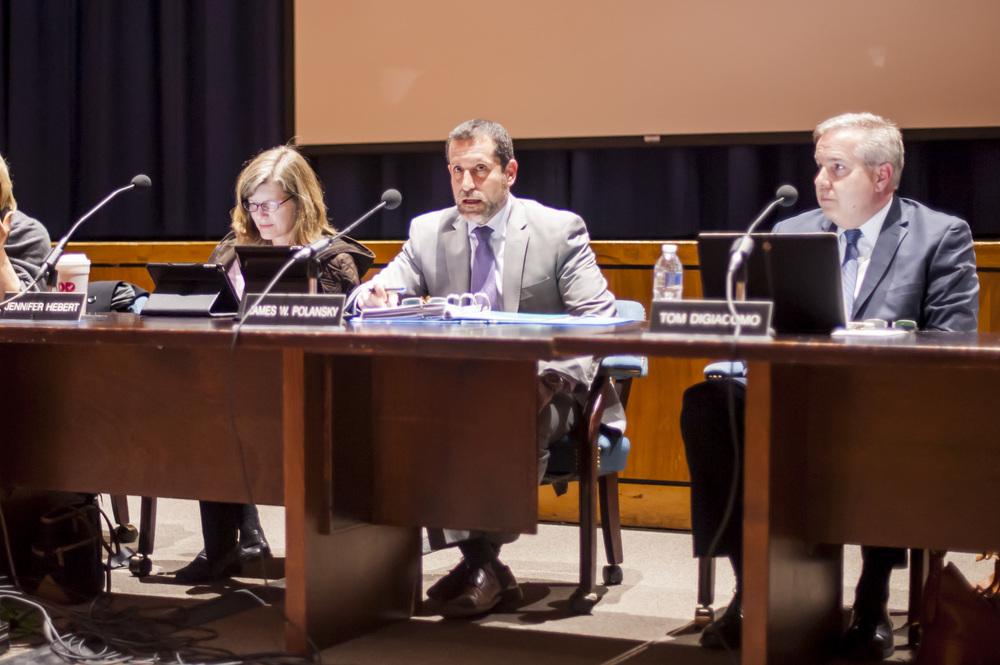 Huntington School District Superintendent James Polansky, center, said in a written response to the Office of the New York State Comptroller Thomas DiNapoli that the district overestimated expenses for three fiscal years from 2012-13 through 2014-15 due to unforeseen financial situations, including the delayed re-opening of the Jack Abrams STEM Magnet School.
