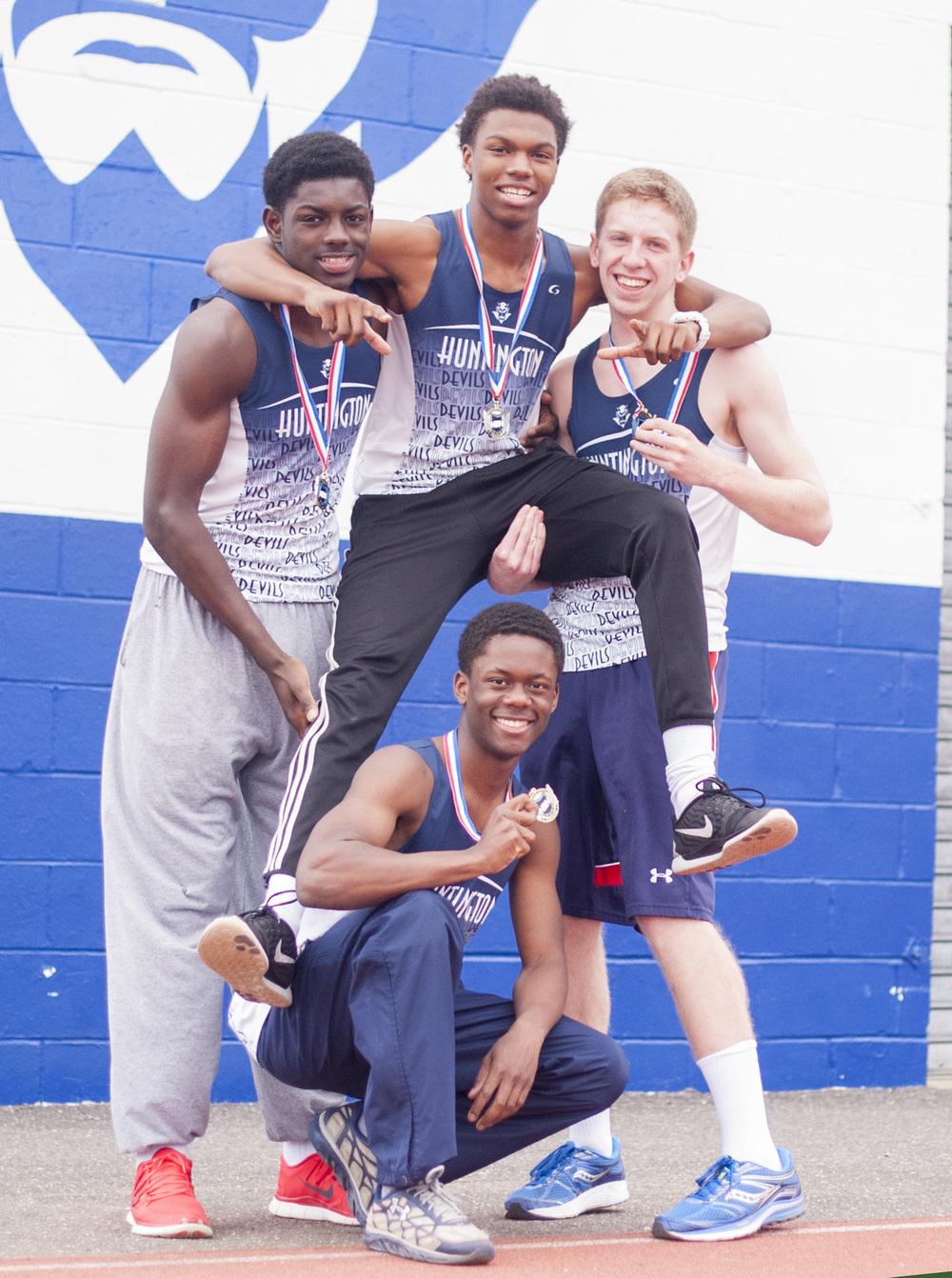 The Huntington Blue Devils 4x400-meter relay team – from left, back row, Infinite Tucker, Kyree Johnson and Shane McGuire; and Lawrence Leake, kneeling – took home a national championship on March 13 during the New Balance Nationals Indoor meet at the Armory in Manhattan.