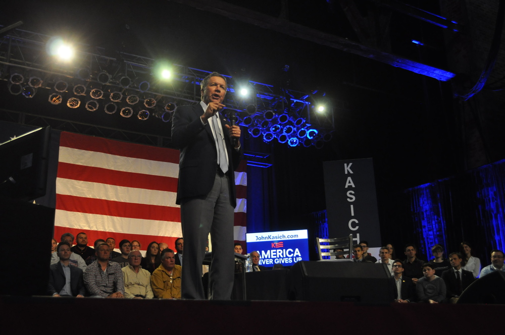 Ohio Governor John Kasich, speaking at The Paramount in Huntington, said he's staying in the race for the Republican presidential nomination despite a poor showing in the delegate count and is looking forward to an open convention. Photo by Danny Schrafel