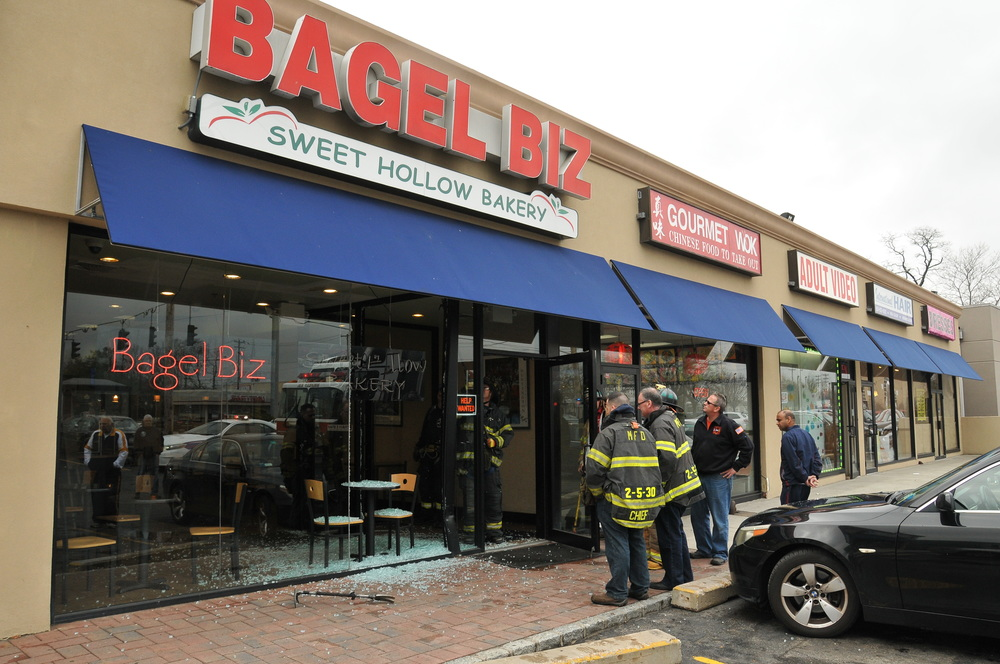 Fire officials said a vehicle crashed through the Bagel Biz storefront on Walt Whitman Road in Melville on Saturday.    Photo by Steve Silverman