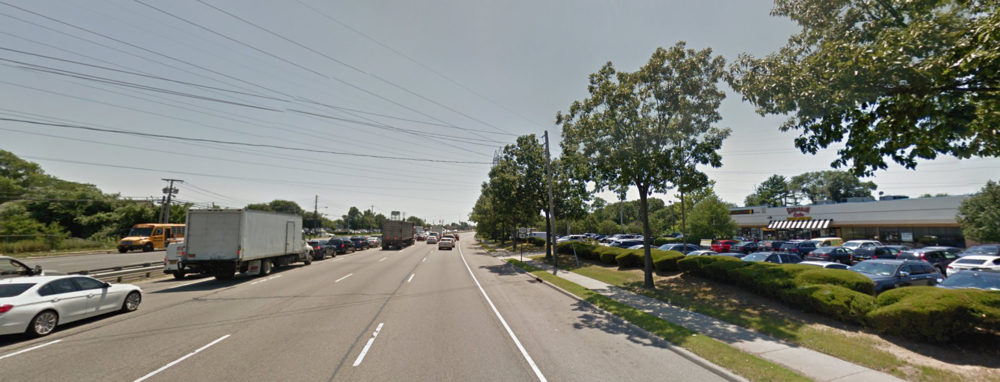 Suffolk police said a Commack man overdosed while driving last week, crashing his car into another vehicle carrying a mother and her two children along this stretch of Broadhollow Road in Melville. Photo/Google Maps