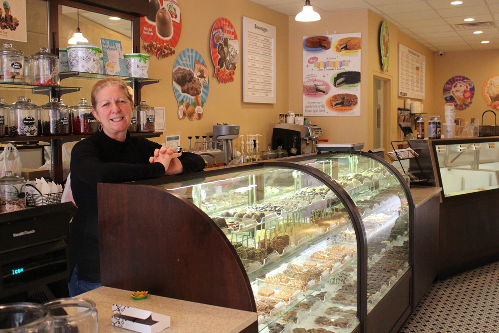 Susan Hirschfeld, co-owner of Kilwins in Huntington village, offers an assortment of fudge, candy and 32 different flavors of ice cream at the sweet shop.