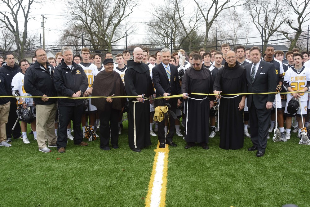 Among those who cut the ribbon at St. Anthony's High School's newly-unveiled James C. Metzger Stadium is James C. Metzger; St. Anthony's Principal Bro. Gary Cregan; Bro. Christopher Thurneau, OSF; Director of Development Don Corrao; Huntington Councilwoman Tracey Edwards; and school administration, lacrosse coaches and members of the varsity lacrosse team.    Photo/Ray O'Connor Photography