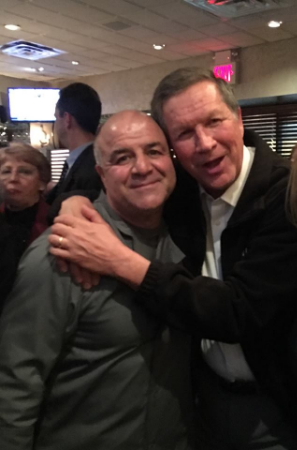 Sal D's owner Sal Meringolo, left, gets a thank you hug from Ohio Governor and Republican presidential hopeful John Kasich at the restaurant Monday. Photo courtesy of Katie Bancheri Mittelman