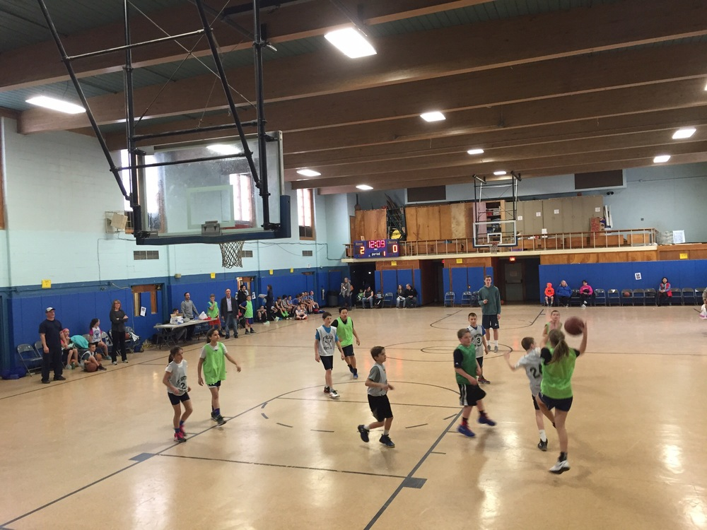 The 5th and 6th grade classes of Saint Anthony of Padua Church face off in Saturday's round-robin basketball tournament fundraiser hosted as an effort to raise money to build a medical clinic for a village in Kisoro, Uganda.