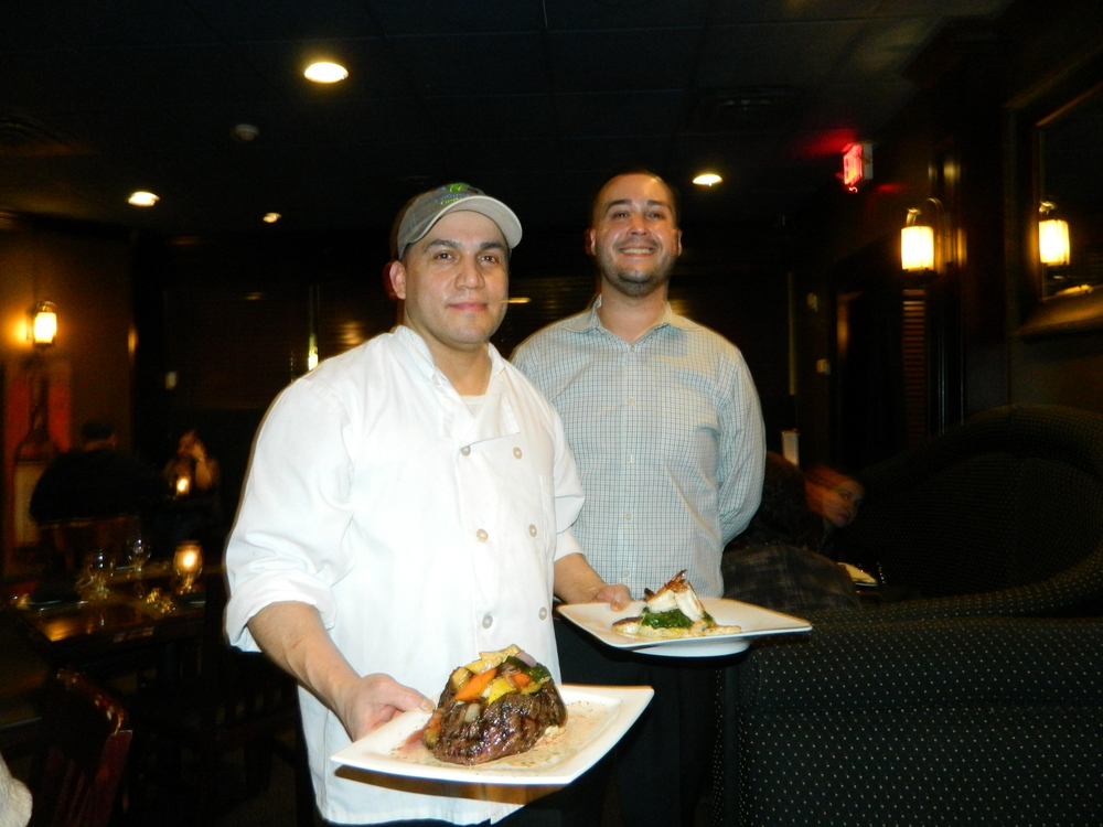 Black & Blue Chef David Guzman and General Manager Rocco Furgiuele present the 16 oz skirt steak and Sauteed Shrimp and Scallops.