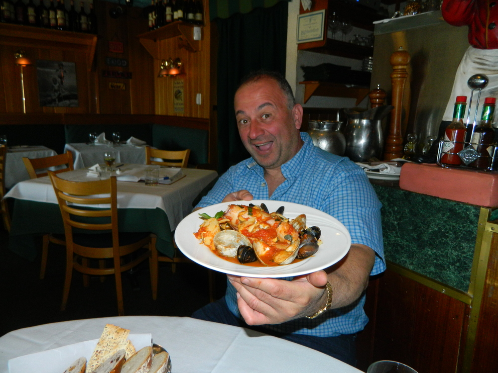 Nader Gebrin, owner and chef at Bravo! Nader, presents the restaurant's stuffed calamari over linguine with mussels, clams and scungilli in red sauce.