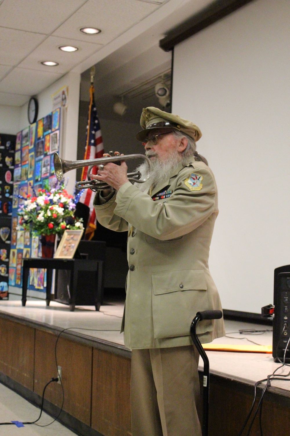 William Thomas, Jr., a B-17 pilot in the U.S. Army Corps during WWII, plays 'Taps' at the Veterans Testimonial Project at Half Hollow Hills Community Library on Saturday.
