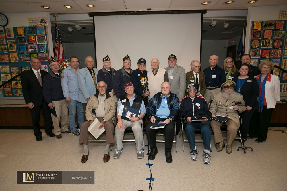 The second annual Veterans Testimonial Project ceremony honored 12 local veterans for their service in World War II, Korean War, Vietnam and peacetime. Top row, left to right: Suffolk Legislator Steve Stern; Charles Armstrong; Ed Canova; Friedel J. Grashoff; Edward O'Shea; Robert Santo; Herbert R. Tuckman; Gerald H. Weintraub; Morton Laurence; Robert A. Frank; Lawrence J. Schroeder; Huntington Councilwoman Susan Berland; Paul Hennings (representative of state Senator John Flanagan's office). Bottom row, left to right: Harold S. Stulbaum; Joseph Abbondondelo; William E. Lauter; Louis Peretz; William W. Thomas Jr.; Executive Half Hollow Hills Community Library Director Helen Crosson; and Edna Susman, librarian. Photo by Len Marks