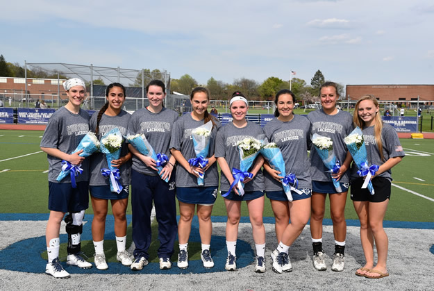 The Huntington girls lax team's eight seniors are honored Monday on Senior Day.   Photo/Huntington School District